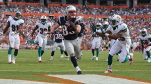 Dec 2, 2012; Miami Gardens, FL, USA;  New England Patriots wide receiver Wes Welker (83) runs for a touchdown against the  Miami Dolphins in the second quarter at Sun Life Stadium. Mandatory Credit: Robert Mayer-USA TODAY Sports