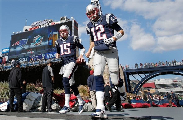 Oct 27, 2013; Foxborough, MA, USA; New England Patriots quarterback Tom Brady (12) and quarterback Ryan Mallett (15) take the field bebore their game against the Miami Dolphins at Gillette Stadium. Mandatory Credit: Winslow Townson-USA TODAY Sports
