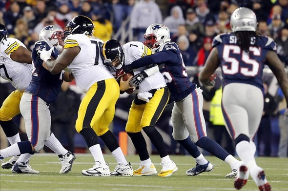 Nov 3, 2013; Foxborough, MA, USA; Pittsburgh Steelers quarterback Ben Roethlisberger (7) is sacked by New England Patriots defensive end Chandler Jones (95) in the second quarter at Gillette Stadium. Mandatory Credit: David Butler II-USA TODAY Sports