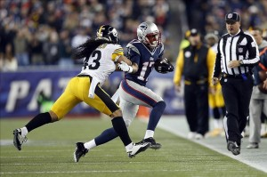 Nov 3, 2013; Foxborough, MA, USA; New England Patriots wide receiver Aaron Dobson (17) gets pushed out of bounds by Pittsburgh Steelers safety Troy Polamalu (43) during the second quarter at Gillette Stadium. Mandatory Credit: Greg M. Cooper-USA TODAY Sports