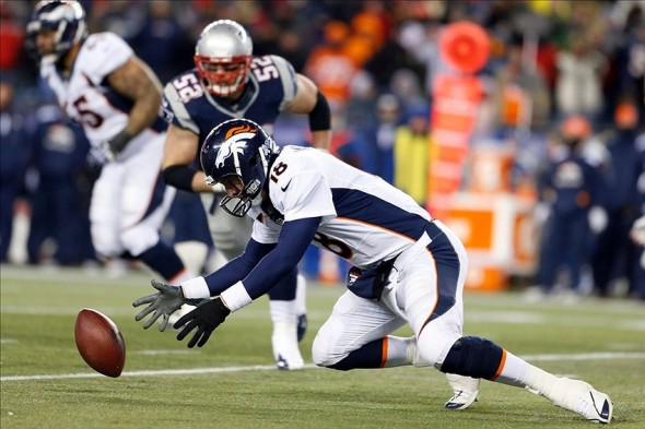 Peyton Manning fumbles under pressure from Patriots linebacker Dane Fletcher