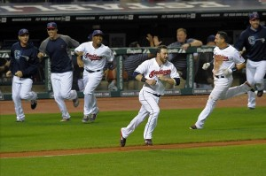 Sep 19, 2013; Cleveland, OH, USA; Second baseman Jason Kipnis (center) and the Cleveland Indians celebrate a 2-1 win over the Houston Astros in the eleventh inning at Progressive Field. Mandatory Credit: David Richard-USA TODAY Sports