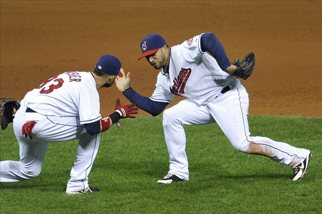 Sep 25, 2013; Cleveland, OH, USA; Cleveland Indians first baseman Nick Swisher (left) and shortstop Mike Aviles celebrate a 7-2 win over the Chicago White Sox at Progressive Field. Mandatory Credit: David Richard-USA TODAY Sports