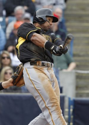 Feb 27, 2014; Tampa, FL, USA; Pittsburgh Pirates left fielder Chris Dickerson (25) hits a RBI single during the sixth inning against the New York Yankees at George M. Steinbrenner Field. Mandatory Credit: Kim Klement-USA TODAY Sports