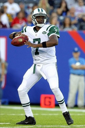 Aug 24, 2013; East Rutherford, NJ, USA; New York Jets quarterback Geno Smith (7) drops back to pass against the New York Giants during the first quarter of a preseason game at MetLife Stadium. Mandatory Credit: Brad Penner-USA TODAY Sports