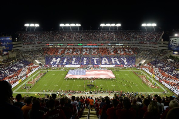 An overall inside view of Raymond James Stadium as fans honor military and veterans during an NFL football game between the Miami Dolphins and the Tampa Bay Buccaneers , Monday, November 11, 2013 in Tampa Bay, Florida. 50,00 cards were provided to fans by USAA, the official military appreciation sponsor of the NFL. (David Drapkin/AP images for USAA/)