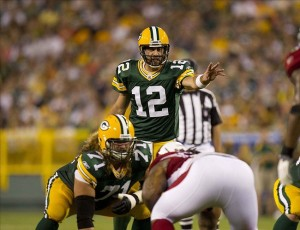 Aug 19, 2011; Green Bay, WI, USA; Green Bay Packers quarterback Aaron Rodgers (12) signals prior to a play during the game against the Arizona Cardinals at Lambeau Field. The Packers defeated the Cardinals 28-20. Mandatory Credit: Jeff Hanisch-US PRESSWIRE