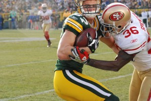 Jordy Nelson takes a hit against the 49ers. He is the toughest and most consistent Packer. Raymond T. Rivard photograph