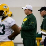 May 10, 2013; Green Bay, WI, USA; Head coach Mike McCarthy (center) and general manger Ted Thompson (right) watch workout during the Green Bay Packers rookie orientation weekend. Mandatory Credit: Benny Sieu-USA TODAY Sports