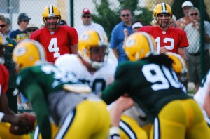Brett Favre and Aaron Rodgers watch the team work out during a summer training camp back in 2006. Raymond T. Rivard photograph