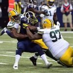 Green Bay Packers linebacker Andy Mulumba (46) and Packers defensive tackle Johnny Jolly (97) tackle St. Louis Rams running back Benny Cunningham (45) for a 2 yard loss during the first half at the Edward Jones Dome. Scott Rovak-USA TODAY Sports photograph