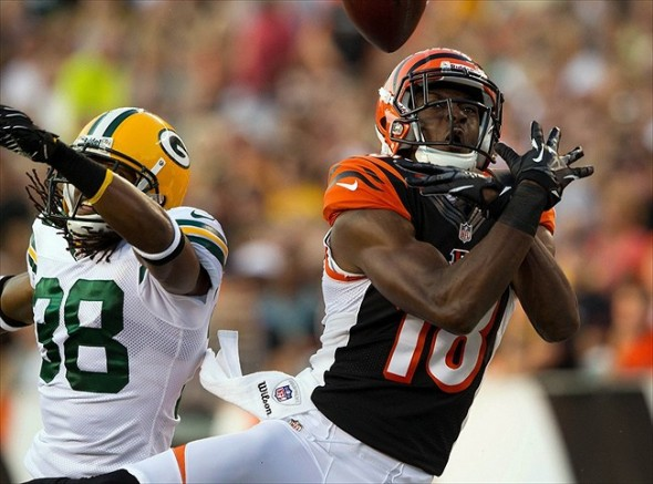 Green Bay Packers defensive back Tramon Williams breaks up a fade pattern to Cincinnati Bengals wide receiver A.J. Green during the pre-season game at Paul Brown Stadium. Rob Leifheit-USA TODAY Sports photograph