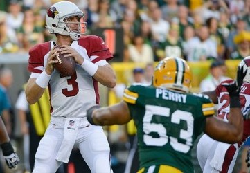 Aug 9, 2013; Green Bay, WI, USA; Arizona Cardinals quarterback Carson Palmer looks to pass while under pressure from Green Bay Packers linebacker Nick Perry (53) at Lambeau Field. Mandatory Credit: Benny Sieu-USA TODAY Sports