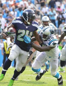 Marshawn Lynch runs as Thomas Davis defends in the fourth quarter. Bob Donnan-USA TODAY Sports photograph