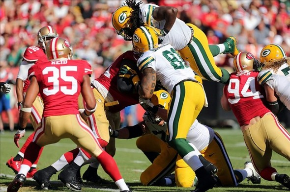Sep 8, 2013; San Francisco, CA, USA; Green Bay Packers running back Eddie Lacy (27) scores a touchdown over the pile against the San Francisco 49ers during the fourth quarter at Candlestick Park. The San Francisco 49ers defeated the Green Bay Packers 34-28. Mandatory Credit: Kelley L Cox-USA TODAY Sports