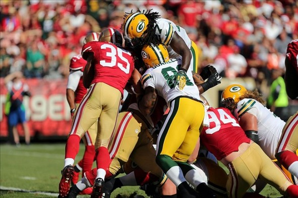 Eddie Lacy scores a touchdown over the pile against the San Francisco 49ers. Kelley L Cox-USA TODAY Sports photograph