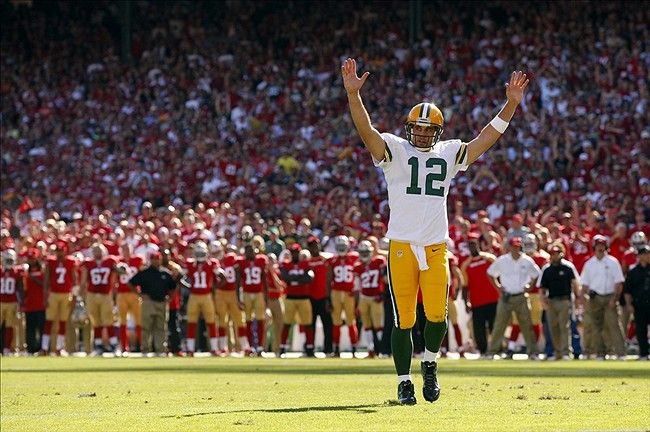 Green Bay Packers quarterback Aaron Rodgers reacts after running back Eddie Lacy (not pictured) scored a touchdown against the San Francisco 49ers in the fourth quarter at Candlestick Park. Cary Edmondson-USA TODAY Sports photograph