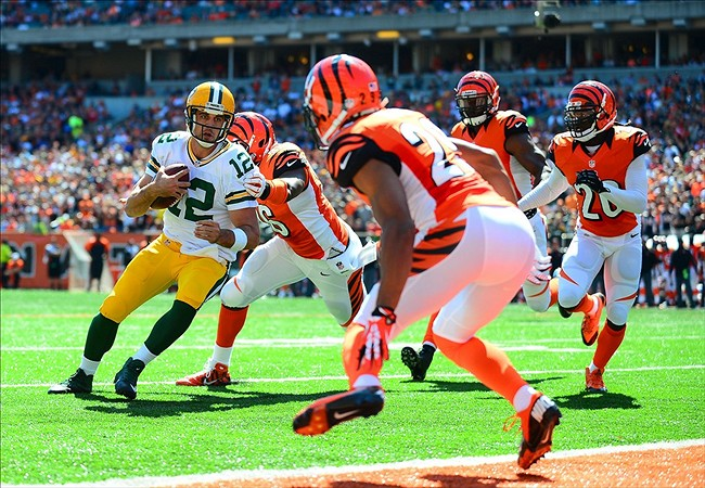Aaron Rodgers attempts to score against the Bengals. However, he was shoved out at the one yard line and the Packers had to settle for a field goal.