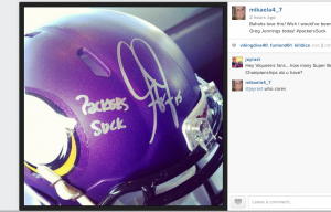 "Greg Jennings signature with his alleged ""Packers Suck"" addition."