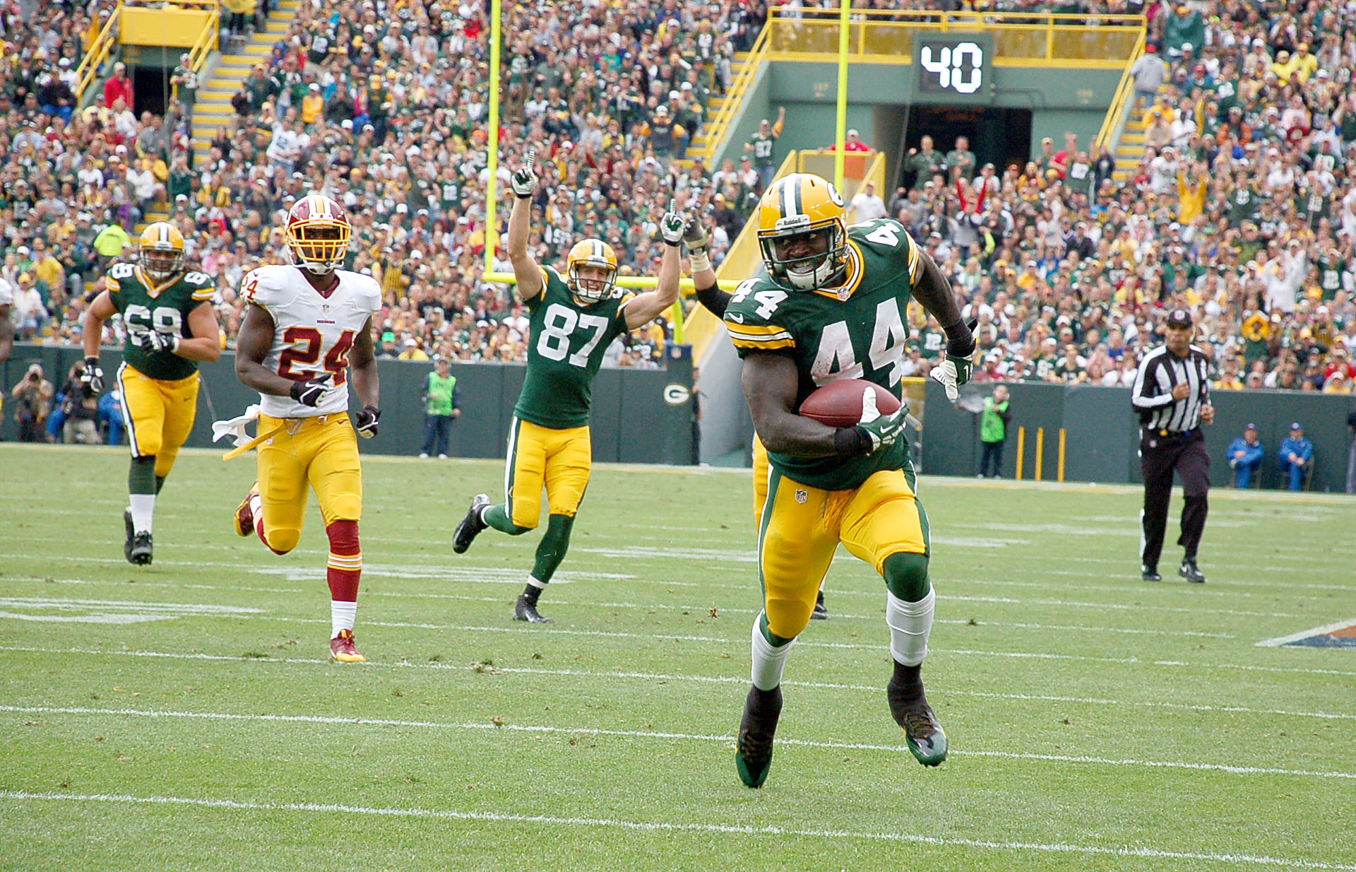 James Starks runs for a second half touchdown while Jordy Nelson celebrates the score. Brian Jopek photograph
