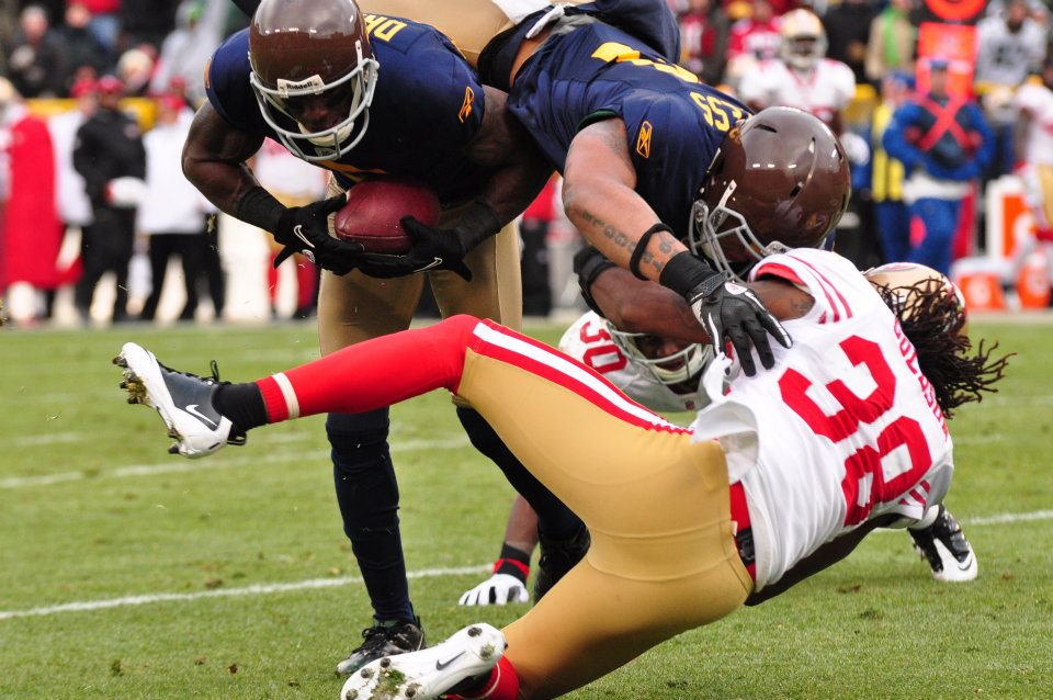 With a block by Andrew Quarless on Dashon Goldson, former Packer wide receiver Donald Driver breaks free on what he called the greatest play of his career. He scored the touchdown while wearing the throwback uniforms in 2010. Raymond T. Rivard photograph