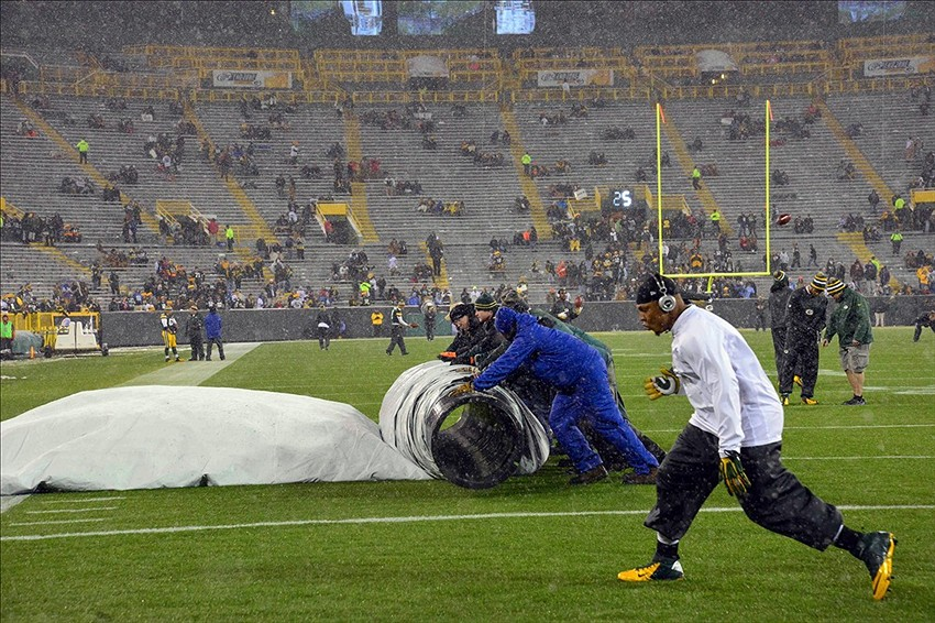 Dec 9, 2012; Green Bay, WI, USA; Workers remove snow from the field before the game between the Green Bay Packers and Detroit Lions at Lambeau Field. Mandatory Credit: Benny Sieu-USA TODAY Sports
