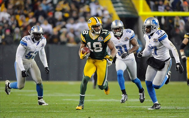 Green Bay Packers wide receiver Randall Cobb (18) finds an opening between Detroit Lions linebacker Justin Durant (52), cornerback Drayton Florence (31) and cornerback Pat Lee (27) at Lambeau Field. Benny Sieu-USA TODAY Sports photograph