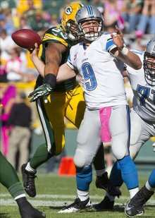 Nick Perry knocks the football away from Matthew Stafford. Jeff Hanisch-USA TODAY Sports photograph
