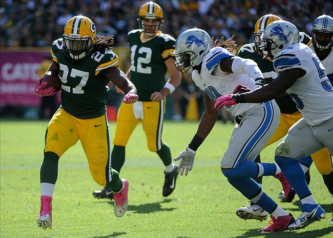 Eddie Lacy runs for yards against Detroit Lions defensive end Willie Young (79) in the fourth quarter at Lambeau Field. Benny Sieu-USA TODAY Sports