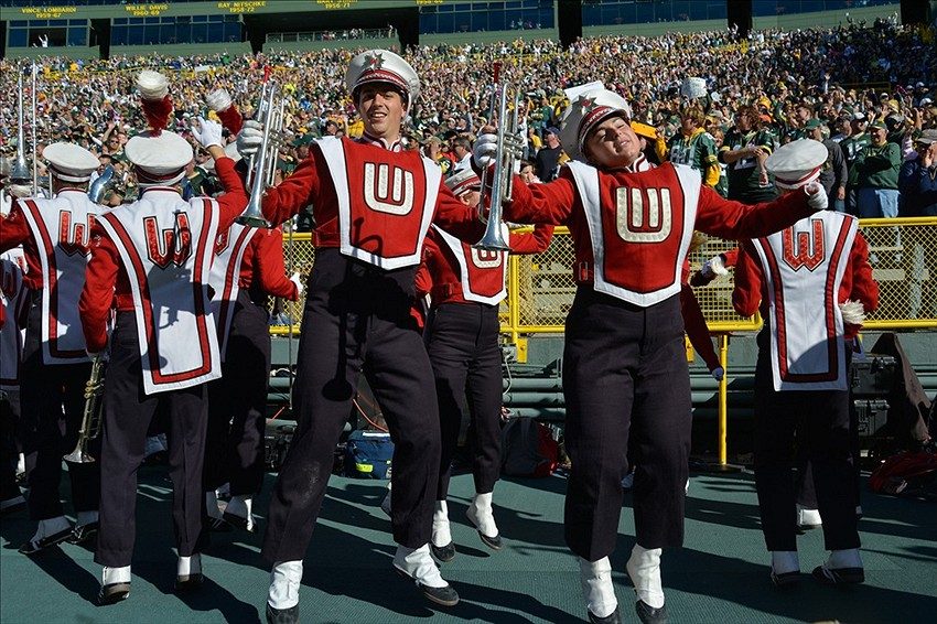 The University of Wisconsin marching band celebrates a 22-9 win by the Green Bay Packers over the Detroit Lions at Lambeau Field. There is no sighting of Dominic Raiola in this photograph. Benny Sieu-USA TODAY Sports photograph