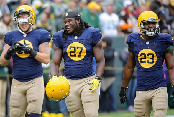 Oct 20, 2013; Green Bay, WI, USA; Green Bay Packers running back Eddie Lacy (27) laughs with tight end Jake Stoneburner (85) and running back Johnathan Franklin (23) before game against the Cleveland Browns at Lambeau Field. Mandatory Credit: Benny Sieu-USA TODAY Sports