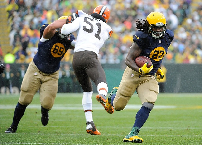 Green Bay Packers running back Eddie Lacy (27) runs past Cleveland Browns linebacker Barkevious Mingo (51) in the first quarter at Lambeau Field. Benny Sieu-USA TODAY Sports photograph