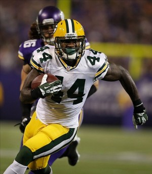Oct 27, 2013; Minneapolis, MN, USA; Green Bay Packers running back James Starks (44) rushes for a 25 yard touchdown against the Minnesota Vikings in the fourth quarter at Mall of America Field at H.H.H. Metrodome. Mandatory Credit: Bruce Kluckhohn-USA TODAY Sports