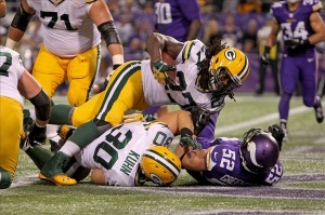 Eddie Lacy scores a touchdown during the third quarter against the Minnesota Vikings at Mall of America Field at H.H.H. Metrodome. Brace Hemmelgarn-USA TODAY Sports