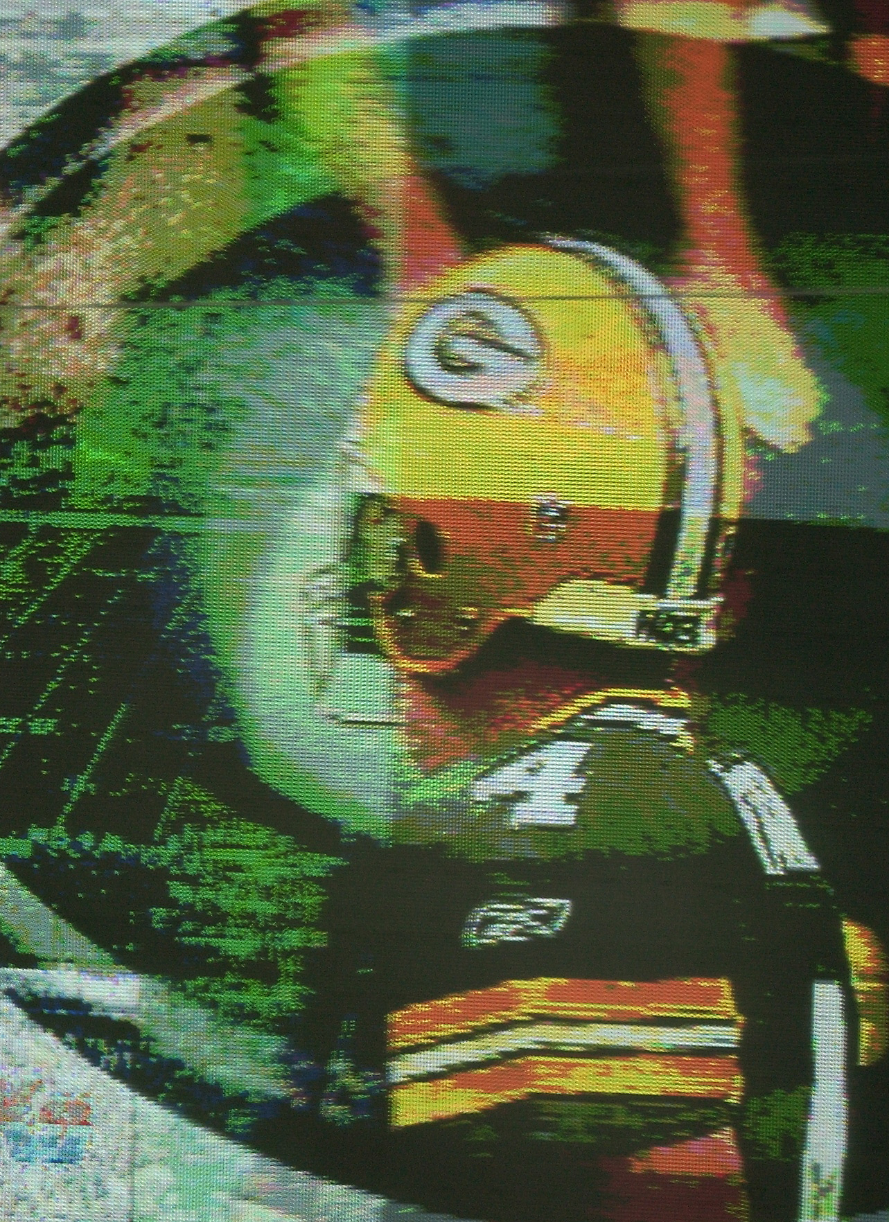 Brett Favre, whose birthday is today, was photographed on the stadium screen with the team's logo fading in behind his image. Raymond T. Rivard photograph