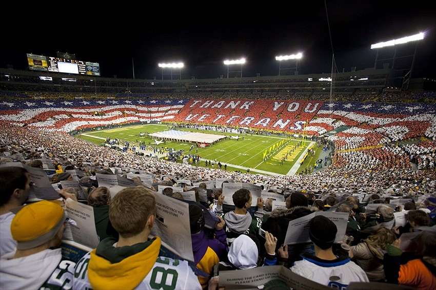 Nov 14, 2011; Green Bay, WI, USA; Fans hold up signs during a card stunt during the national anthem prior to the game between the Minnesota Vikings and Green Bay Packers at Lambeau Field. Mandatory Credit: Jeff Hanisch-USA TODAY Sports