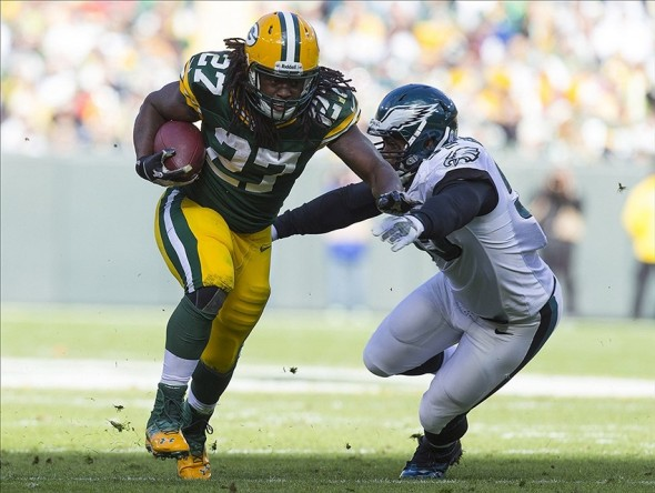 Nov 10, 2013; Green Bay, WI, USA; Green Bay Packers running back Eddie Lacy (27) runs with the ball as Philadelphia Eagles linebacker Brandon Graham (55) tackles during the second quarter at Lambeau Field. The Eagles won 27-13. Mandatory Credit: Jeff Hanisch-USA TODAY Sports
