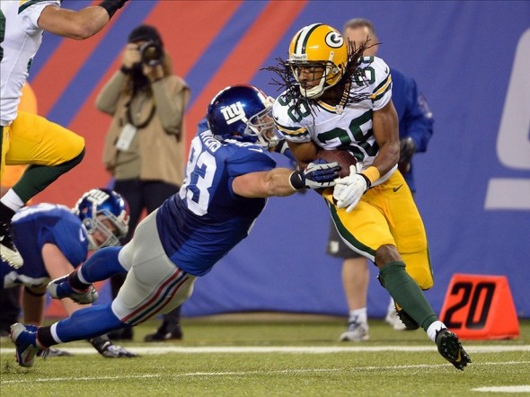 Tramon Williams avoids the tackle of Brandon Myers after making an interception. Robert Deutsch-USA TODAY Sports photograph
