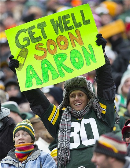 A Green Bay Packers fan holds up a sign supporting Aaron Rodgers. Jeff Hanisch-USA TODAY Sports photograph