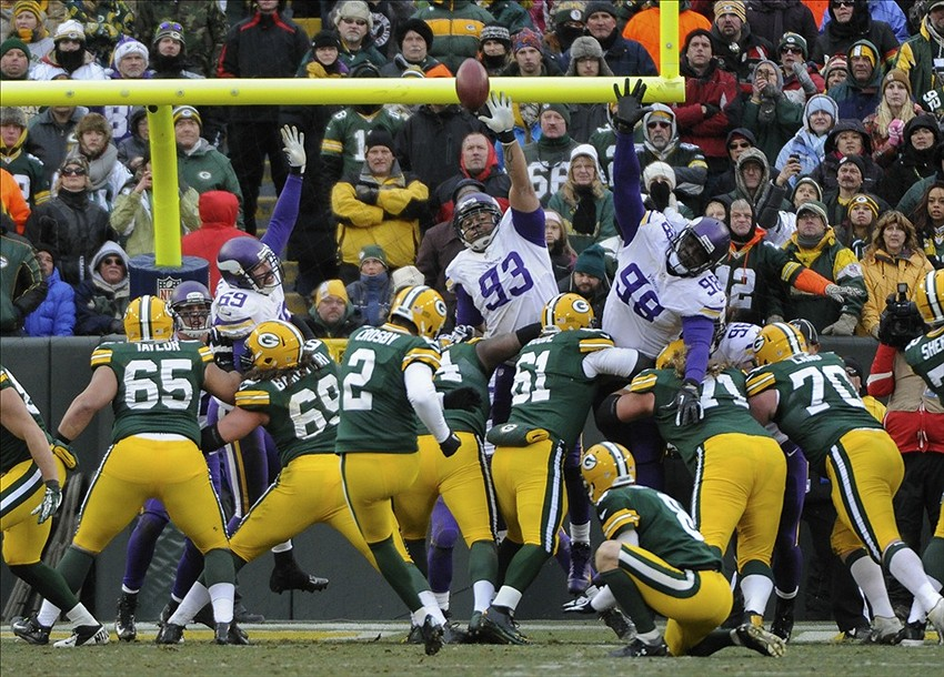 Mason Crosby kicks a field goal against Minnesota Vikings defensive tackle Kevin Williams and defensive tackle Letroy Guion. Benny Sieu-USA TODAY Sports photograph