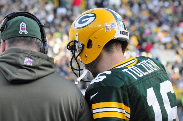 Scott Tolzien looks over the play chart with head coach Mike McCarthy. Raymond T. Rivard photograph