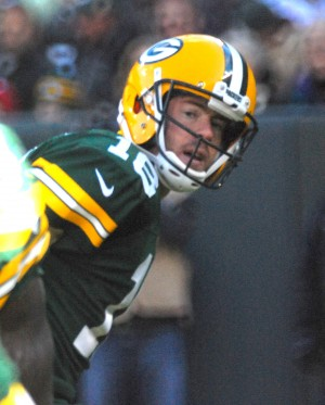 After handing off to Eddie Lacy, Scott Tolzien watches the play unfold. Raymond T. Rivard photograph