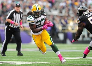 Oct 13, 2013; Baltimore, MD, USA; Green Bay Packers running back Eddie Lacy (27) runs with the ball during the game against the Baltimore Ravens at M