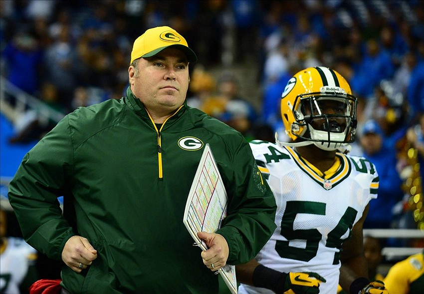 Nov 28, 2013; Detroit, MI, USA; Green Bay Packers head coach Mike McCarthy on the runs onto the field prior to the start of a NFL football game against the Detroit Lions on Thanksgiving at Ford Field. Mandatory Credit: Andrew Weber-USA TODAY Sports