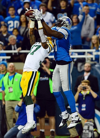 Sam Shields intercepts a pass intended for Detroit Lions wide receiver Calvin Johnson. Andrew Weber-USA TODAY Sports