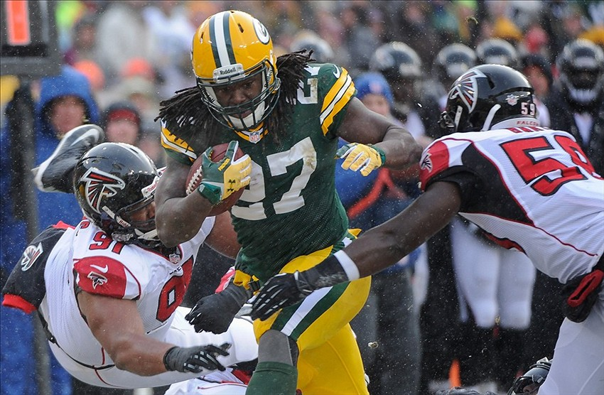 Eddie Lacy ran hard all day. On this run he plows through Atlanta Falcons defensive tackle Corey Peters (91) and linebacker Joplo Bartu (59) for a first down in the first quarter at Lambeau Field. Benny Sieu-USA TODAY Sports photograph