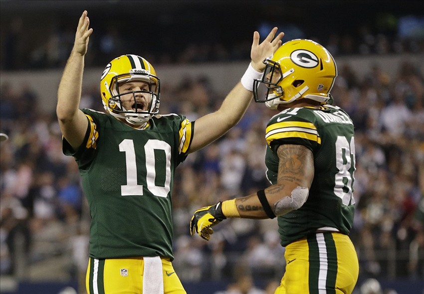 Green Bay Packers quarterback Matt Flynn (10) reacts to a touchdown with tight end Andrew Quarless in the fourth quarter at Dallas on Sunday.