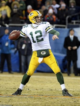Aaron Rodgers (12) drops back to pass against the Chicago Bears during the fourth quarter. Mike DiNovo-USA TODAY Sports photograph