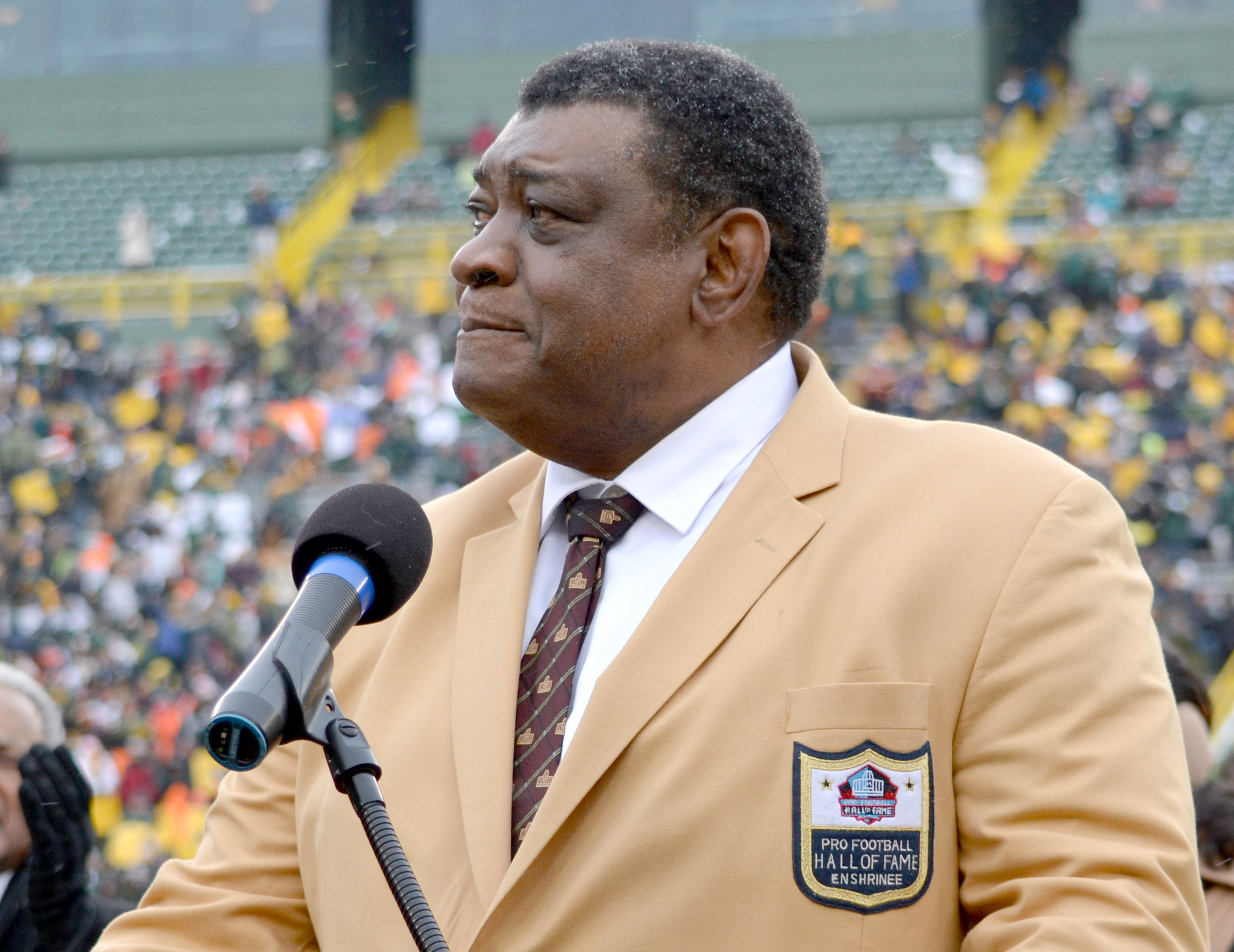 Dave Robinson pauses during his acceptance speech during a ceremony held at halftime Sunday honoring his inclusion in the Packers Ring of Honor and his induction into the Pro Football Hall of Fame. Jim Oxley photograph