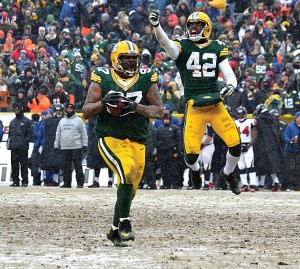 Packers safety Morgan Burnett whoops it up after Johnny Jolly recovered a second half against the Atlanta Falcons. Jim Oxley photograph